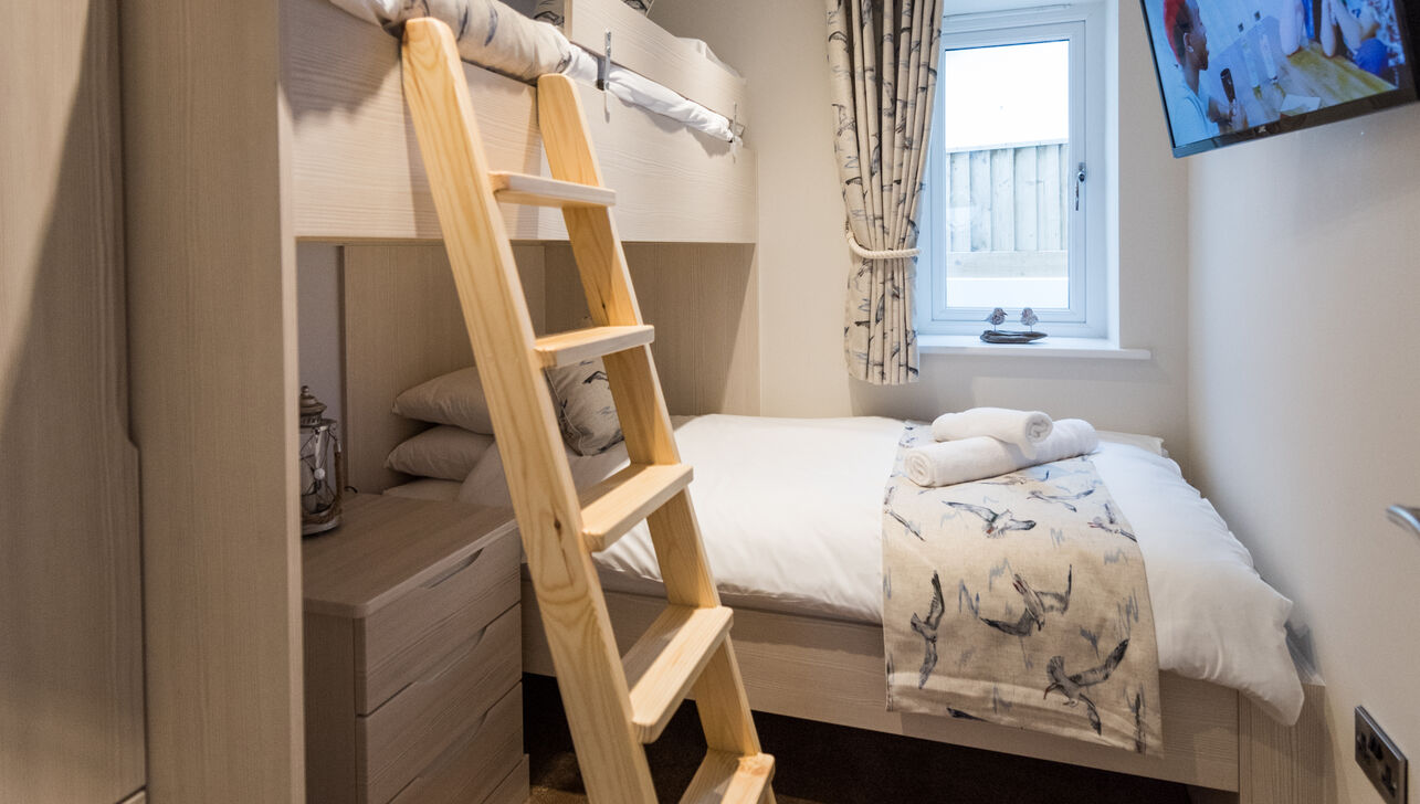 double bed and above bunk bed at driftwood holiday apartment